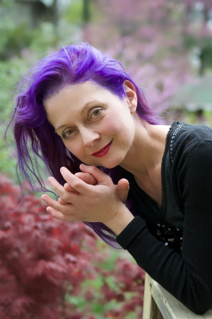Nada-purple-683x1024